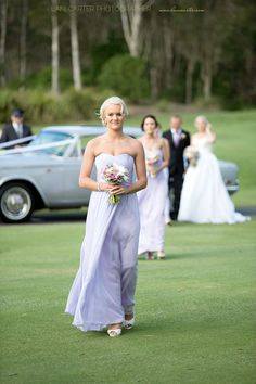 Bridesmaids walking down the aisle at Twin Waters Golf Club. www.lanicarter.com