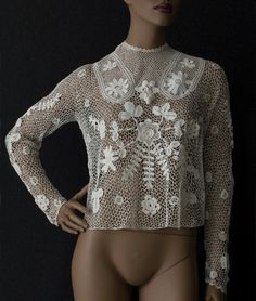 Irish crochet lace blouse, c.1905. The variety and piquant charm of the schematic floral motifs is truly memorable. The centerpiece is the blooming rose on the bodice. Radiating from the center are the dependent, budding florets and sprigs. The blouse has not been altered in design to make it more wearable for the modern woman. The longer-in-front, blouson style is correct for the period.