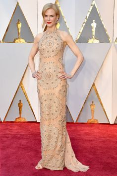 Best SupportingActress nominee for Lion,Nicole Kidman pairedhersleeveless ArmaniPrivé gown with a red lip.
