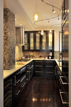 Contemporary Kitchen with Pendant light, electric cooktop, Custom built-in wine rack, Undermount sink, gas range, Flush