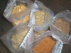 make your own chick starter by grinding and mixing some organically grown grains