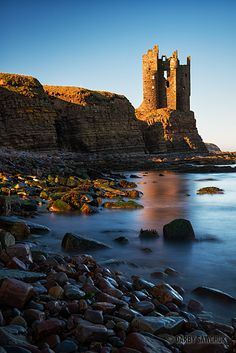 The ruin of Old Keiss Castle balances precariously on a cliff on the coast of Caithness, Scotland.