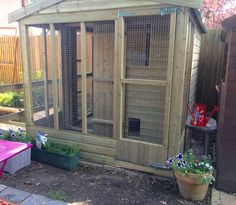 All sorts of rabbit housing idea for you to view. Great ideas, lots of fun and ways to make your bunnies' housing an attractive feature in the garden/home as well as a fantastic environment for. Bunny Sheds, Rabbit Shed, Rabbit Hutch Plans, Outdoor Rabbit Hutch, Rabbit Run, Rabbit Cages, Rabbit Hutches, Bunny Rabbit, Diy Bunny Hutch