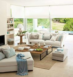 White, blue & blue touches. Incredible living room.