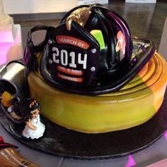 Fire Helmet & Hose Groom's Cake | Shared by LION Fancy Cakes, Cute Cakes, Gorgeous Cakes, Amazing Cakes, Firefighter Wedding, Firefighter Family, Groomsman Cake, Fire Cake, Fire Fighter Cake