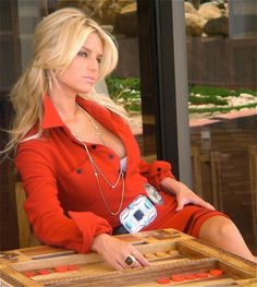 Jessica Simpson super sexy in an open red dress photoshoot for her fashion line