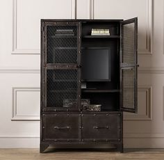 RH baby&child's Vintage Industrial Steel Cabinet:Built entirely of steel, our industrial-inspired storage cabinet stands ready to corral all manner of children's treasures, from classic books and toys to contemporary electronics.