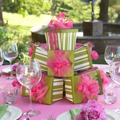 Fun idea for a centerpiece - The tapered boxes are super-cute, but you could do it cheaply with regular boxes and wrapping paper to match your party's colors. Could even include take-home gifts for each guest in the boxes.