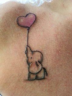 Elephant with heart balloon