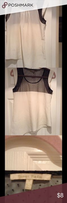 Asymmetrical top Adorable soft silky asymmetrical style ivory color top longer Bon one side. Black lace near armholes and across upper back. Looks great with leggings, capris or jeans. Worn only once. Excellent condition Sweet rain Tops