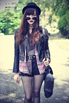 .Love the plaid and leather jacket together.