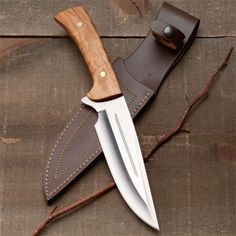 "European Sheath Knife. Italian in origin (overall length 11-1/2) with solid brass pins holding a heavy, wide 6"" blade plus a sewn leather sheath for carry. It's arguably as stylish as any we have seen in years. Full length tang. 440C S Steel."