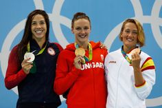 (L-R) Silver medalist Maya Dirado of the United States of America, gold medal medalist Katinka Hosszu and bronze medalist Mireia Belmonte Garcia of Spain pose during the medal ceremony for the Final of the Women's 400m Individual Medley on Day 1 of the Rio 2016 Olympic Games at the Olympic Aquatics Stadium on August 6, 2016 in Rio de Janeiro, Brazil.