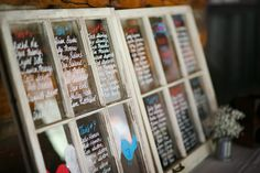 Or how about this idea?  Write your seating chart on the glass of reclaimed windows!  wedding decor. seating chart. vintage wedding. rustic wedding. vintage windows.