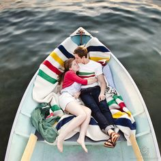 CLICK THIS PIN to see more Muskoka engagement photos. striped blanket, row boat, canadian engagement, Hudson's Bay inspired engagement