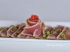 Tuna tataki - Seared tuna sliced thin swimming in a pool of herbs, ponzu, toasted sesame oil, & topped with tabiko