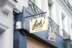 Un fish burger, anyone? Fich in the specializes in UK-style fast food, but its playful interior speaks with a French accent. Shop Signage, Fish And Chips, Things To Do Seattle, Fish Burger, Fish And Chip Shop, Paris Cafe, France, Clever Design, Decoration