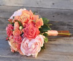 Luscious coral and melon tones in this faux wedding bouquet by Holly's Wedding Flowers.