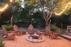 pea gravel, railroad ties, firepit backyard patio by dbrown129