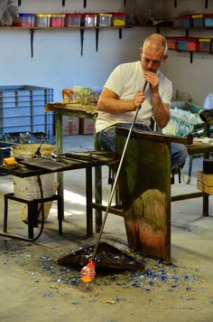 Glass-blowing Venetian artisan keeping an old tradition.  Murano glass