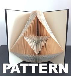 This listing is for a book folding pattern which will enable you to create your own finished book. This pattern: Triforce – 177 folds (354 pages) - 21cm book (minimum) Your pattern will automatically download as a pdf on receipt of payment. You will also receive comprehensive instructions with easy to follow pictures. These will take you through every step of how to fold a book. The instructions will show you how to calculate the number of pages you need in your book in order to complete a…