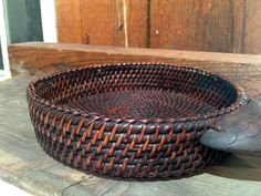 Woven Circular Basket with Wooden Fish Head and by MammothMisc