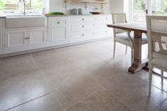 Dijon Tumbled Limestone (Free length x 600mm format) creating a fresh look for a classic kitchen style. Shop this stone http://www.mandarinstone.com/product/_/72/dijon-tumbled-limestone-tile/?cid= #mandarinstone #flooring #stone #kitchen #limestone
