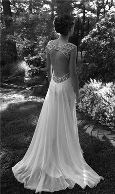 vintage lace wedding dress and beautiful hair style. It really shows the interesting back.