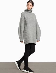 "Grey ribbed oversize sweater with cocoon sleeves. 80% wool , 20% nylonLength 30""Model is wearing one size and model's height is 5.8""Fit is oversize"