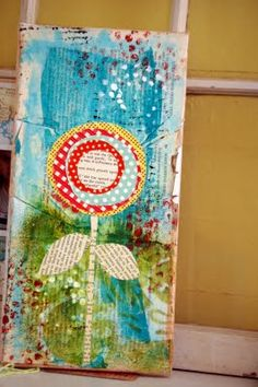 good, detailed tutorial for this pretty collage/painted project. I like the flower made of circles in particular.