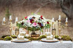 Seriously gorgeous centerpiece with a moss table runner