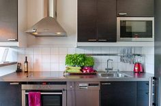 43 Extremely creative small kitchen design ideas - Design with clean lines. Big corbels, ornate cabinetry and fussy details can make a kitchen feel chopped up. Instead, keep the elements tailored and sleek to smooth out the look and create a roomier feel.