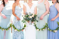 Modern bridesmaids carrying circle wedding bouquets while wearing dresses in shades of blue, green, and floral at a Los Angeles intimate wedding Blue Bridesmaids, Bridesmaid Dresses, Planning A Small Wedding, Father Daughter Dance, Whimsical Fashion, Whimsical Wedding, Chapel Wedding, Intimate Weddings, On Your Wedding Day