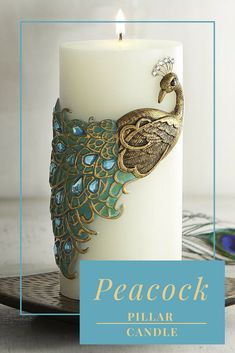 White pillar candle with peacock motif - would make a beautful decor piece. #peacock #decor #ad