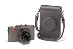 Leica lot -   The special edition of Leica's D-Lux 5 comes with the same features - 10.1 megapixels; 5.1 - 19.2mm f/2 - 3.3 ASPH. zoom lens with a focal length range from 24mm to 90mm (35mm equivalent); and 1,280 x 720 pixel HD movie recording feature - but packaged in a sleek titanium casing.