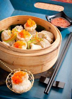 Traditional steamed dim sum (chicken, prawn, and veggie)