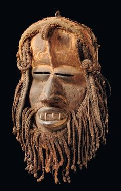 Africa | Face mask from the Ngere people of the Ivory Coast | Wood, fabric and metal