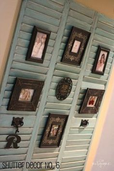 almost-thrown-in-the-garbage shutters into a beautiful way to showcase family photos. Different than my shutter photo display, I like how she added the picture frames on top of the shutter slats, then finished the look with a few accessories like hardware and their name initial. So beautiful and creative! by SAburns