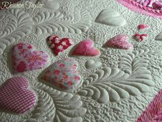 Amazing quilting on this baby quilt - a blog with beautiful quilts..... The Nifty Stitcher