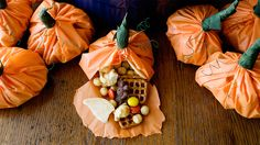 Snack mix wrapped up in a pumpkin costume makes an adorable Halloween treat.