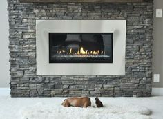 For a warmer cozier home which also saves you money consider gas fireplace inserts. Modern Stone Fireplace, Stone Fireplace Designs, Home Fireplace, Fireplace Remodel, Fireplace Mantels, Fireplace Ideas, Modern Fireplaces, Linear Fireplace, Stone Fireplaces