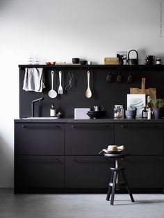 I like the new Ikea Kungsbacka series, especially paired with this concrete flooring. This all matt black kitchen design is beautifully styled by Pella Hedeby. Photography by Ragnar Ómarsson