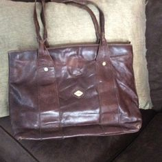 Leather handbag Brown real leather. Made in Italy. Normal wear on the straps. I santi Bags