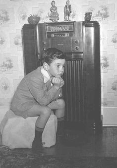 Figure 1.--There is a great interest in old-time radio. Many people still remember the programs they listened to as children. Here we see an American boy with the family Philco, probably in the 1940s.