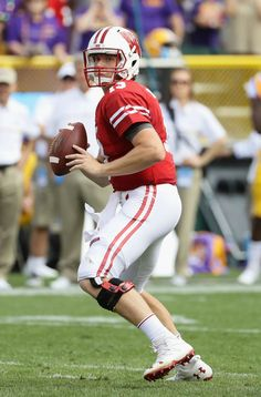 Bart Houston #13 of the Wisconsin Badgers looks to pass the ball during the…