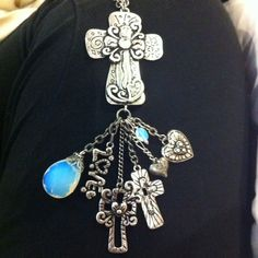 Necklace love....silver crosses and moonstone!