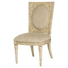 Side chair with fluted front legs and linen upholstery.   Product: ChairConstruction Material: Wood and linen