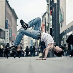 Break dance-kids used to put mats down in the middle of our shopping center and spin around on there heads.