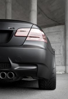 BMW M3 doing its best Batman impression in matte black.