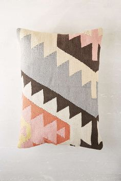 kilim pillow with muted pastels/colors